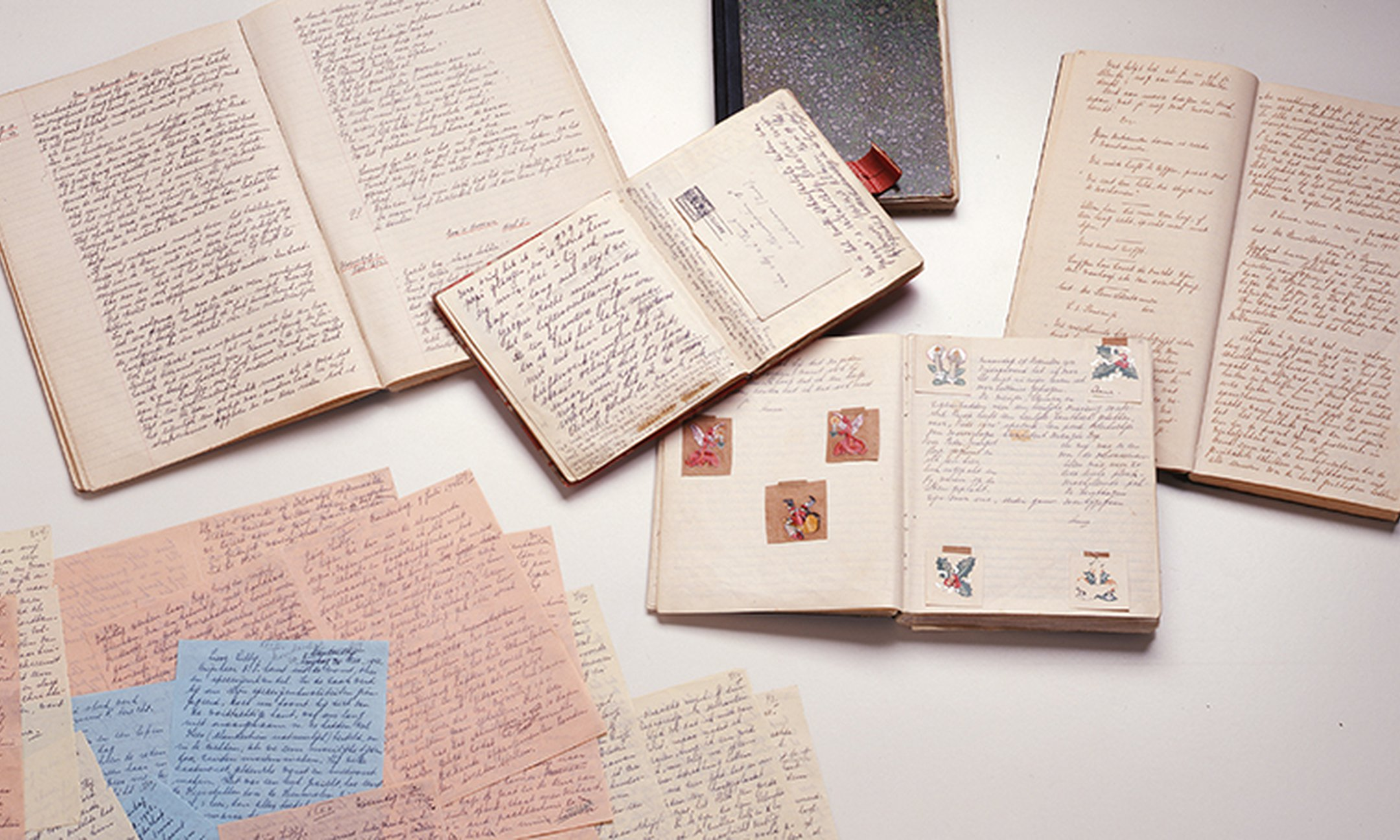 Original manuscripts of Anne Frank, with the diary, the loose sheets, and the notebooks with short stories and beautiful sentences.