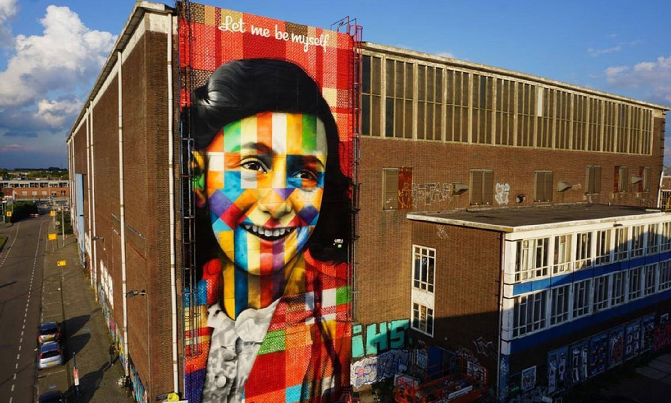 Brazilian artist Eduardo Kobra made a gigantic graffiti portrait of Anne Frank at the NSDM shipyard in Amsterdam.