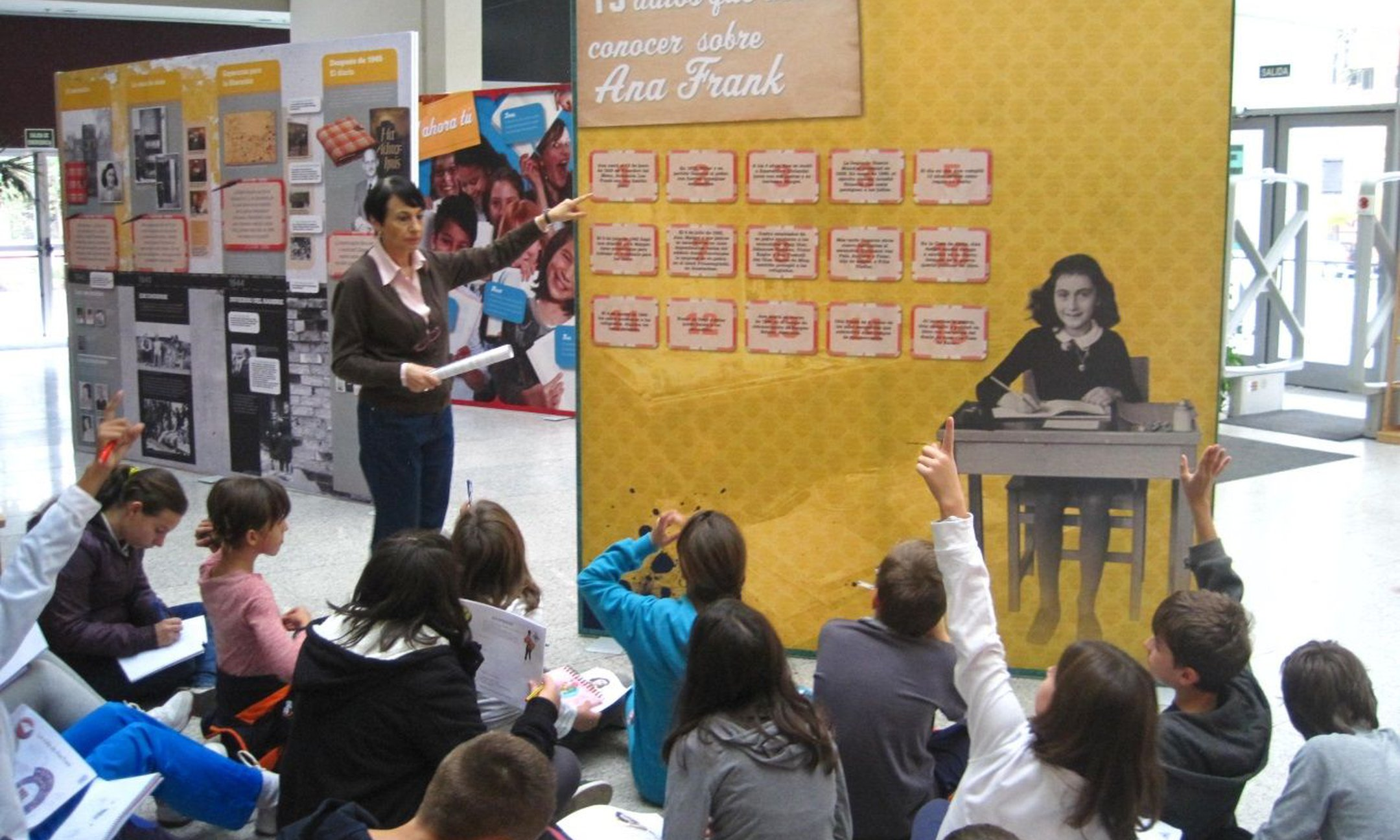 """Students visiting the exhibition """"Reading and Writing with Anne Frank"""" at the public library of Villaverde (Community of Madrid) (November 2014)"""