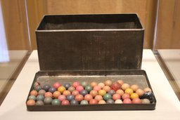 Anne's metal tin with marbles