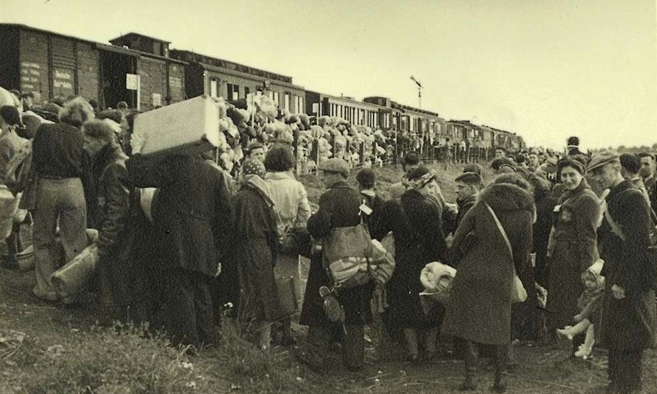 Dutch Jews board the train that is to take them to Auschwitz. Photograph from 1942 or 1943.
