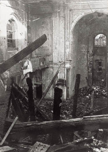 The synagogue of Aachen is set on fire and destroyed during the 'Kristallnacht' of 1938. Otto and Edith Frank were married there in 1925.