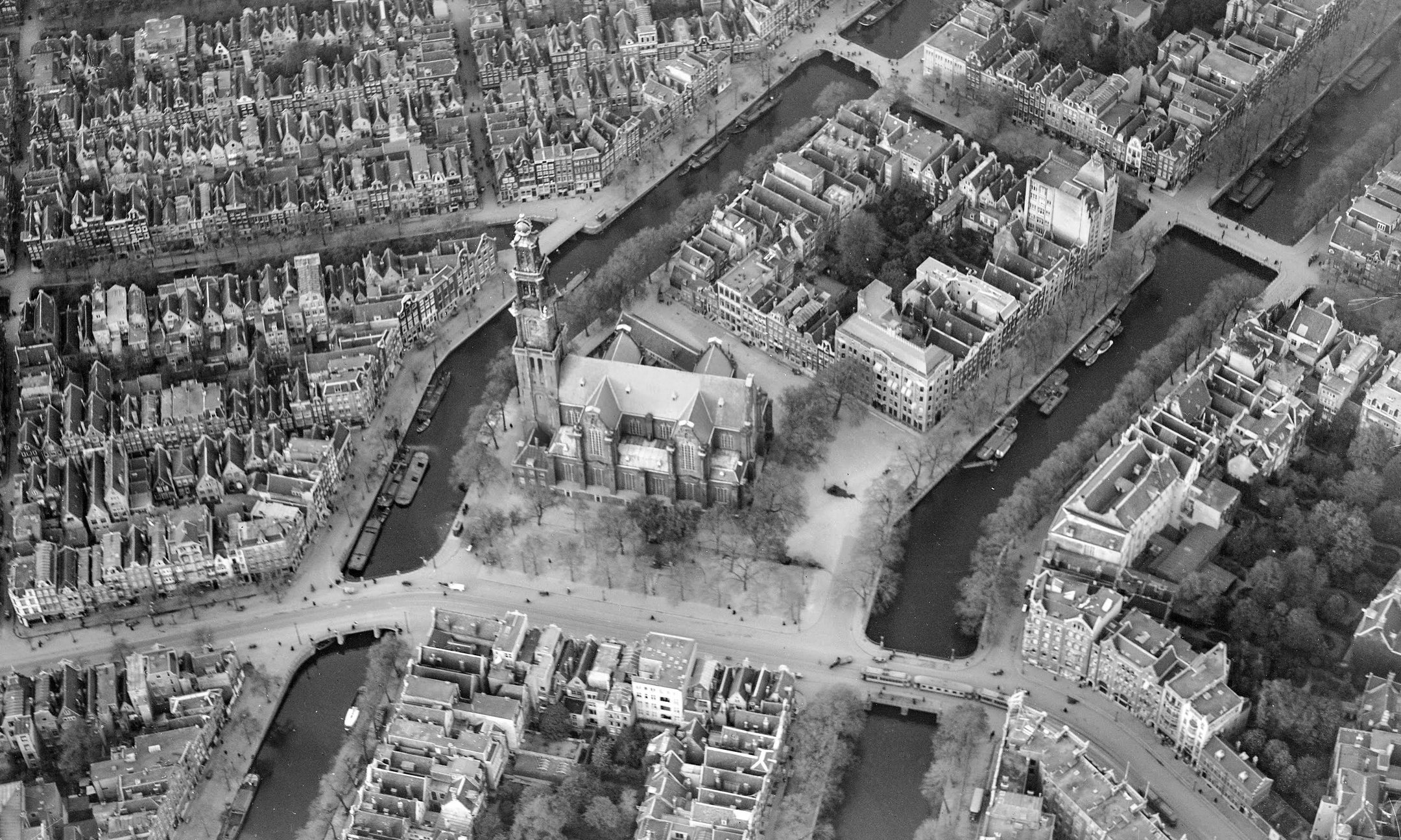 Aerial photo of Amsterdam. The tower of the Westerkerk is in the centre. Prinsengracht 263 is in the block above the tower, next to the canal.