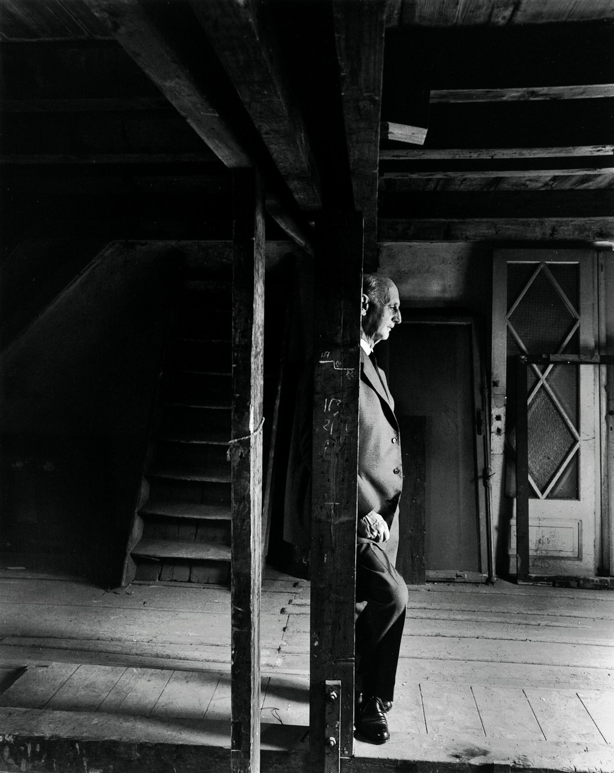 Otto Frank in the attic of the Secret Annex on 3 May 1960, the day the Anne Frank House opens to the public. According to photographer Arnold Newman, Otto was very emotional.