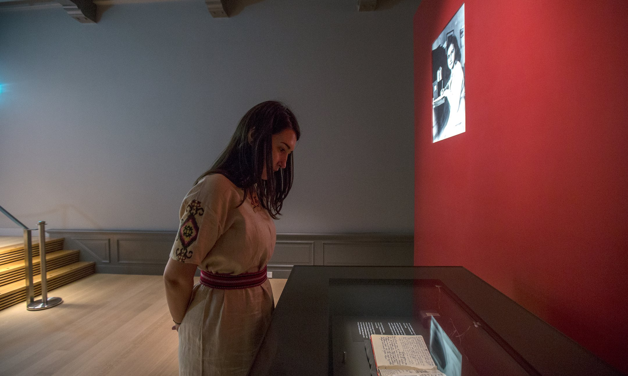 Visitor viewing Anne Frank's original diary
