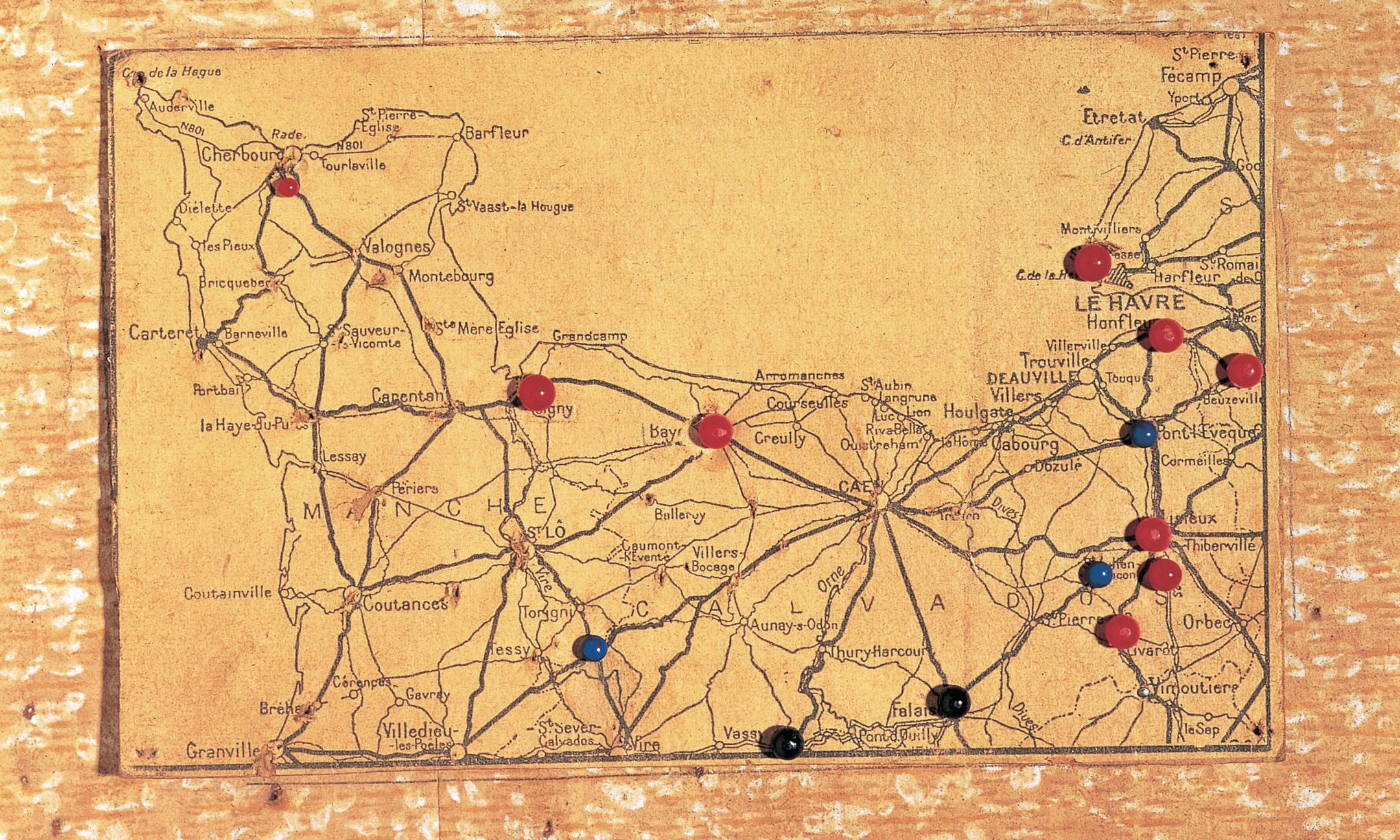 After the Allied landings in France on 6 June 1944, Otto keeps track of their progress by sticking pins in this small map.