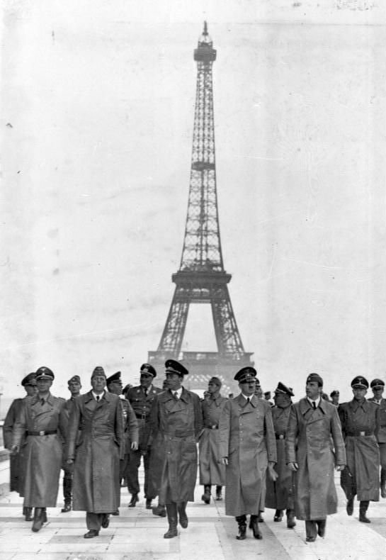 Adolf Hitler visits Paris on 23 June 1940, after the city has fallen into German hands. Here, Hitler and his entourage walk past the Eiffel Tower.