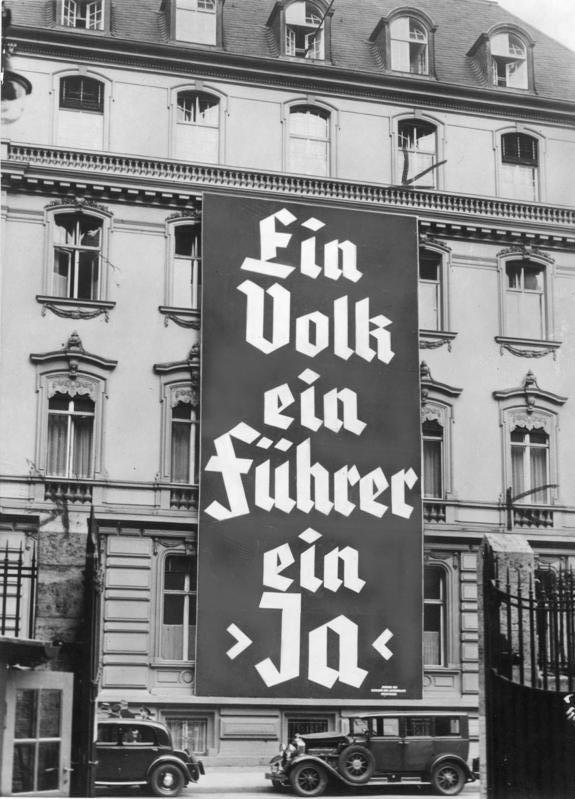 "Election poster from November 1933. The text reads: ""One people, one Führer, one 'yes'"". In these unfree elections, 93.5% of the population says 'yes' to the government policy. Date: November 1933."