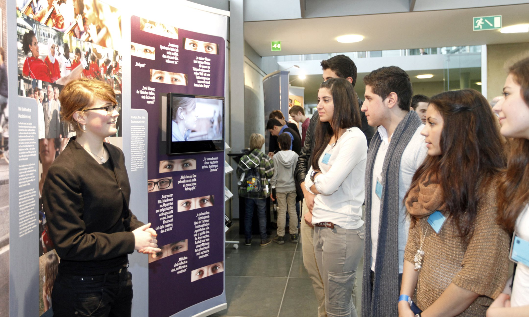 Young people lead other young people through the Anne Frank exhibition